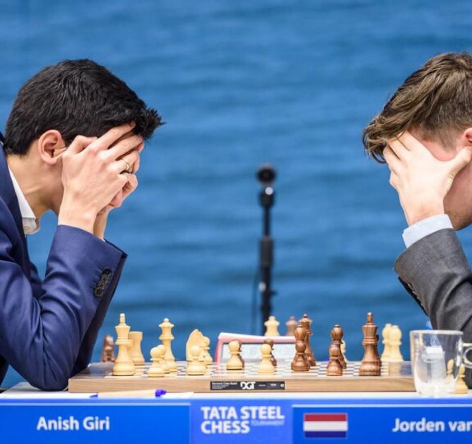 Two players concentrating on the game at the Tata Steel chess tournament round 13-16